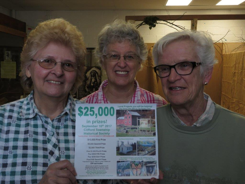 CTHS volunteers Pat Peltz, Sandy Wilmot, and Shirley Granger take a break to talk about their program's big fundraising raffle and the newest display in the Museum of Local History inside Clifford's Community Center. The Museum, along with the restored Hoover School and the Clifford Baptist Church, will be open to the public on the third Sunday of each month, 1:00pm-4:00pm, beginning May 21st.  Volunteer docents are available at each site to greet and inform all visitors. Easter Sunday all venues will be closed.